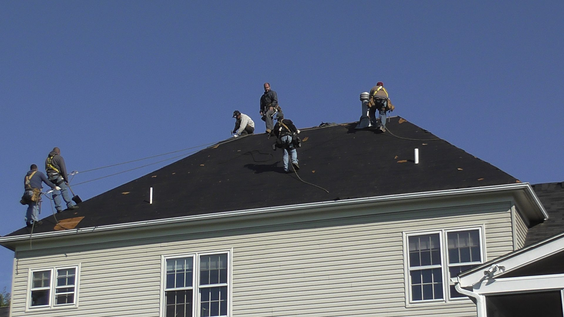 Roofers At Work Affordable Quality Roofing Virginia